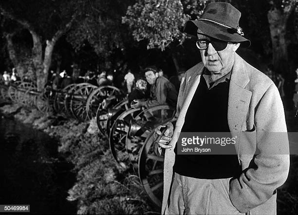 Director John Ford holding cigar and wearing the eye patch he needed late in life on set of Civil War scene the Battle of Shiloh fr his film How the...