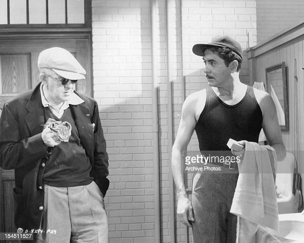 Director John Ford talking to Tyrone Power in between scenes from the film 'The Long Gray Line' 1955