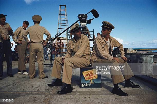 Director John Ford talks to an actor while film stars Henry Fonda and Jack Lemmon take a break during the shooting of Warner Brothers' 'Mister...