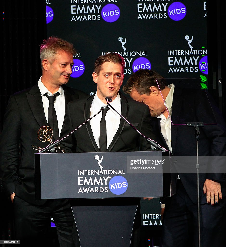 Director John Hay, producer Elliot Jenkins, and principal cast member Eddie Izzard accept the Kids; TV Movie/Mini-Series Emmy Award for 'Lost Christmas' during The Inaugural International Emmy Kids Awards at The Lighthouse at Chelsea Piers on February 8, 2013 in New York City.