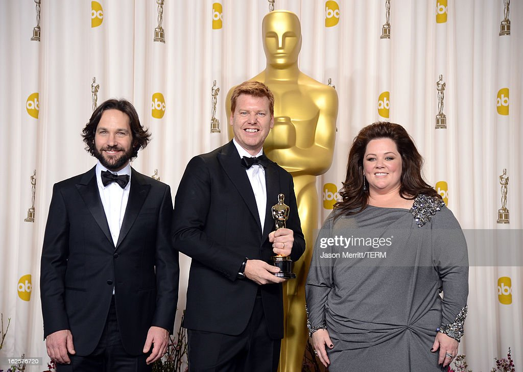 Director John Kahrs (C), winner of the Best Animated Short Film award for 'Paperman,' with presenters Paul Rudd and Melissa McCarthy, pose in the press room during the Oscars held at Loews Hollywood Hotel on February 24, 2013 in Hollywood, California.