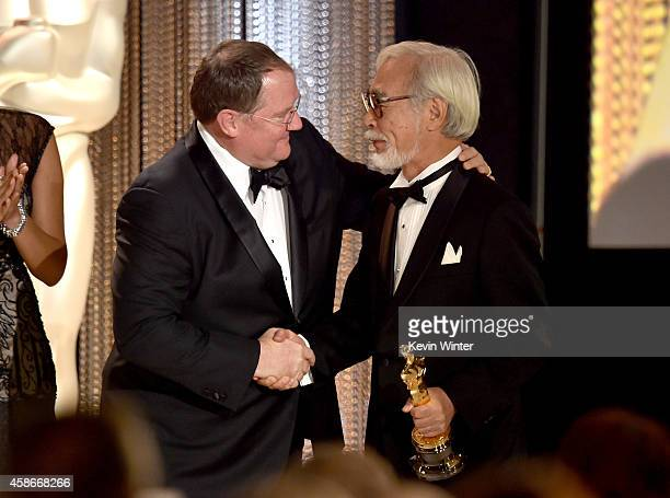 Director John Lasseter presents an Honorary Award to honoree Hayao Miyazaki onstage during the Academy Of Motion Picture Arts And Sciences' 2014...