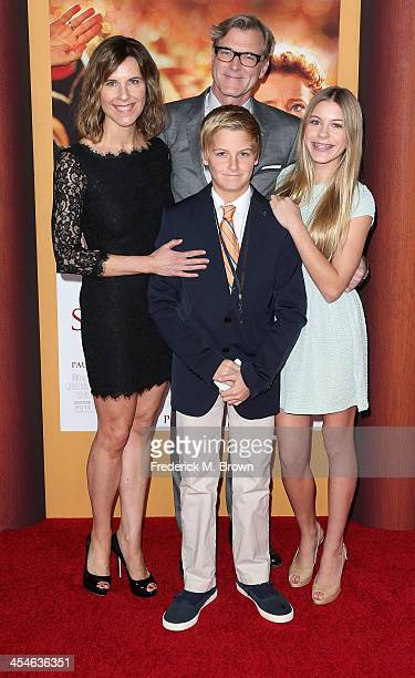 Director John Lee Hancock and his family attend the Premiere of Disney's 'Saving Mr Banks' at Walt Disney Studios on December 9 2013 in Burbank...