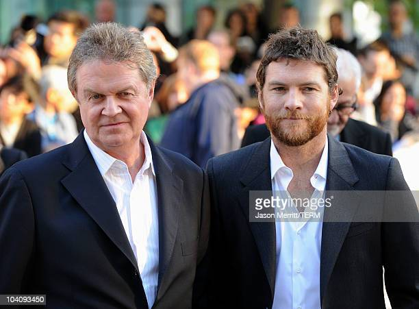 Director John Madden and actor Sam Worthington attend 'The Debt' Premiere during the 35th Toronto International Film Festival at Roy Thomson Hall on...