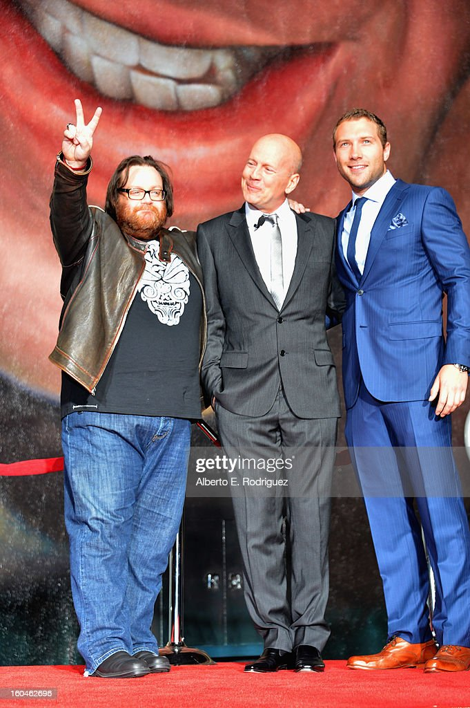 Director John Moore, actor Bruce Willis and actor Jai Courtney attend the dedication and unveiling of a new soundstage mural celebrating 25 years of 'Die Hard' at Fox Studio Lot on January 31, 2013 in Century City, California.