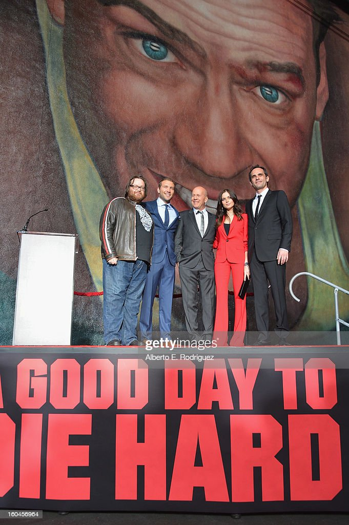 Director John Moore, actors Jai Courtney, <a gi-track='captionPersonalityLinkClicked' href=/galleries/search?phrase=Bruce+Willis&family=editorial&specificpeople=202185 ng-click='$event.stopPropagation()'>Bruce Willis</a>, Julia Snigir and Rasha Bukvic attend the dedication and unveiling of a new soundstage mural celebrating 25 years of 'Die Hard' at Fox Studio Lot on January 31, 2013 in Century City, California.