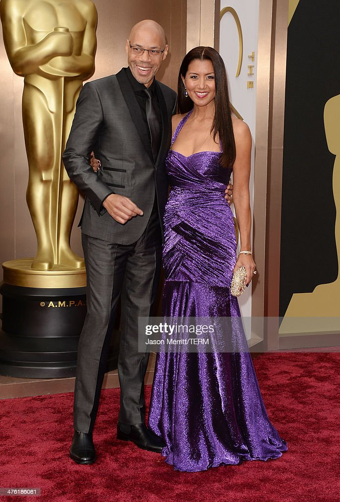 Director John Ridley and Gayle Ridley attend the Oscars held at Hollywood Highland Center on March 2 2014 in Hollywood California
