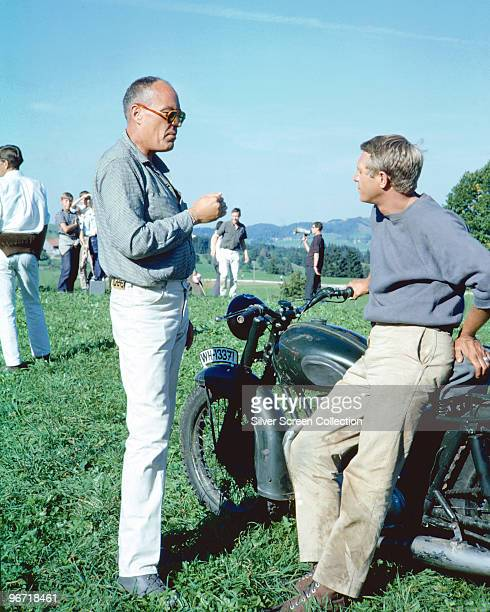 Director John Sturges talks to American actor Steve McQueen on the set of the film 'The Great Escape' 1963
