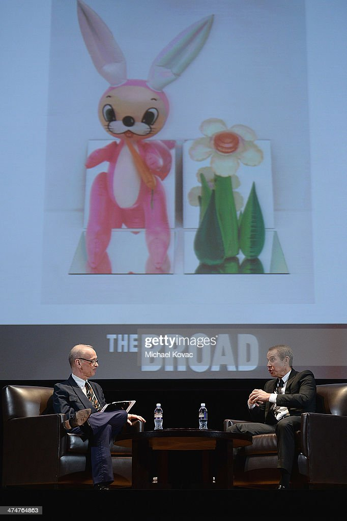 Director John Waters (L) and artist Jeff Koons converse onstage at The Un-Private Collection: Jeff Koons and John Waters in Conversation at Orpheum Theatre on February 24, 2014 in Los Angeles, California.