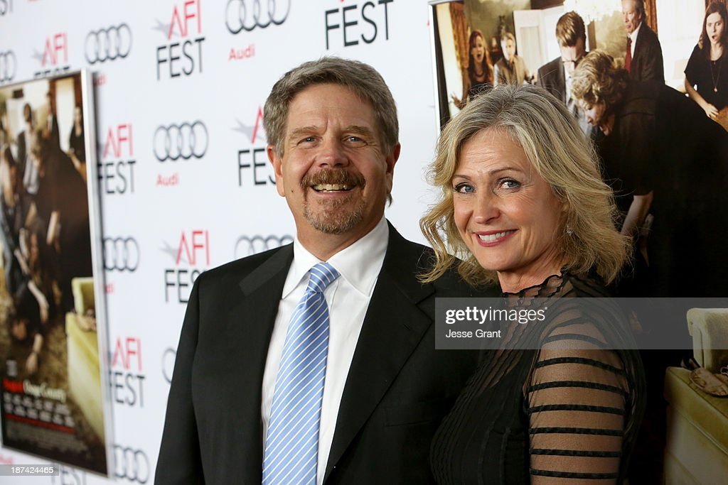Director John Wells (L) and Marilyn Wells attend the premiere of The Weinstein Company's 'August: Osage County' during AFI FEST 2013 presented by Audi at TCL Chinese Theatre on November 8, 2013 in Hollywood, California.