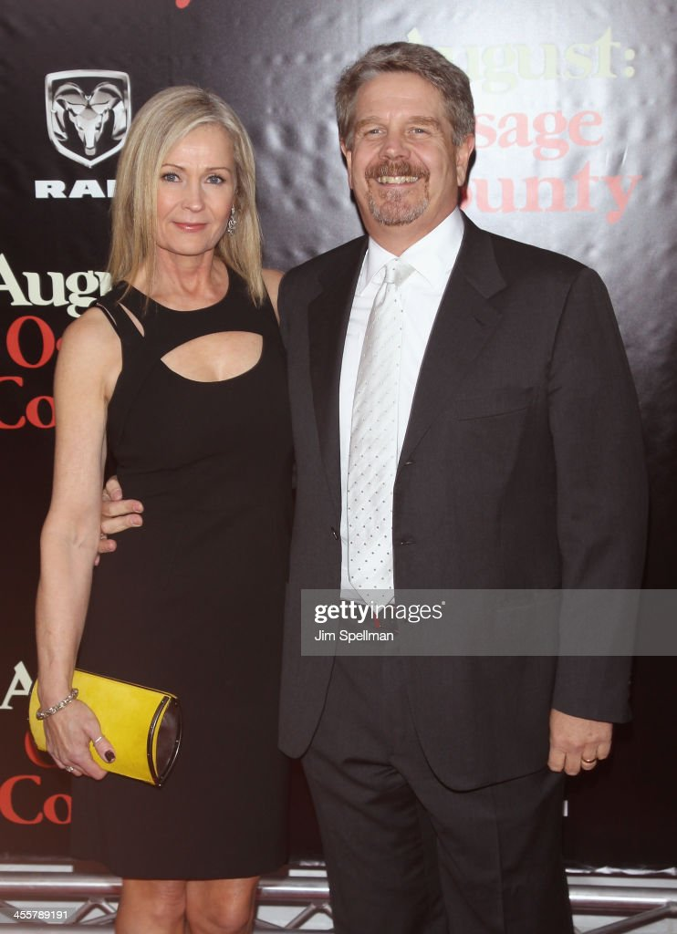 Director John Wells (R) and wife Marilyn Wells attend the 'August: Osage County' premiere at Ziegfeld Theater on December 12, 2013 in New York City.
