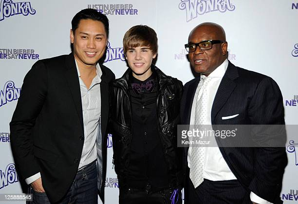 Director Jon M Chu singer Justin Bieber and music producer LA Reid attend the 'Justin Bieber Never Say Never' New York premiere at Regal EWalk 13 on...