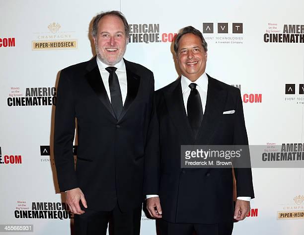 Director Jon Turteltaub and actor Jon Lovitz arrive at the 27th American Cinematheque Award honoring Jerry Bruckheimer at The Beverly Hilton Hotel on...