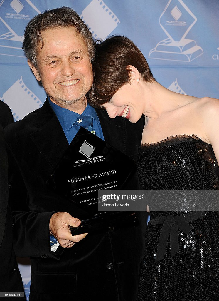 Director Jonathan Demme and actress Anne Hathaway attend the 49th annual Cinema Audio Society Guild Awards at Millennium Biltmore Hotel on February 16, 2013 in Los Angeles, California.