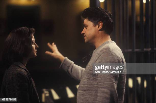 Director Jonathan Demme and actress Jodie Foster are photographed on the set of 'The Silence of the Lambs' in 1989 around Pittsburgh Pennsylvania...