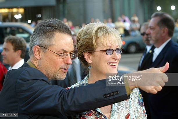 Director Jonathan Demme and actress Meryl Streep pose at the premiere of Paramounts' 'The Manchurian Candidate' at the Samual Goldwyn Theater on July...
