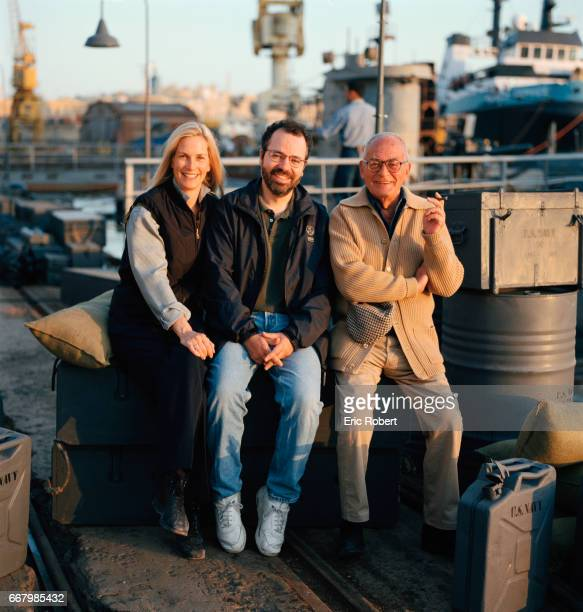 Director Jonathan Mostow sits with producers Martha and Dino De Laurentiis on the set of the 2000 American movie U571 Mostow both wrote and directed...