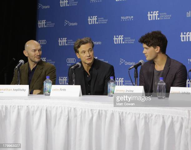 Director Jonathan Teplitzky actor Colin Firth and actor Jeremy Irvine speak onstage at 'The Railway Man' Press Conference during the 2013 Toronto...
