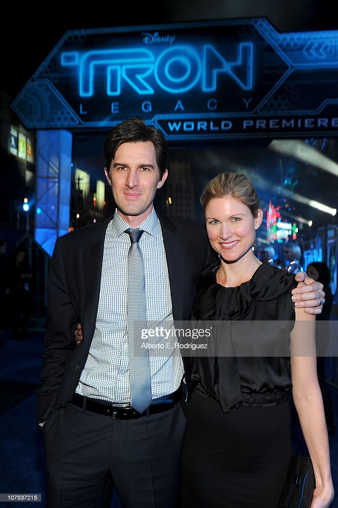 Director Joseph Kosinski (L) and guest arrive at Walt Disney's 'TRON: Legacy' World Premiere held at the El Capitan Theatre on December 11, 2010 in Los Angeles, California.