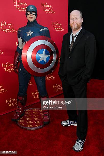 Director Joss Whedon poses with Madame Tussauds Hollywood's figures at the 'Avengers Age of Ultron' premiere at Dolby Theatre on April 13 2015 in...