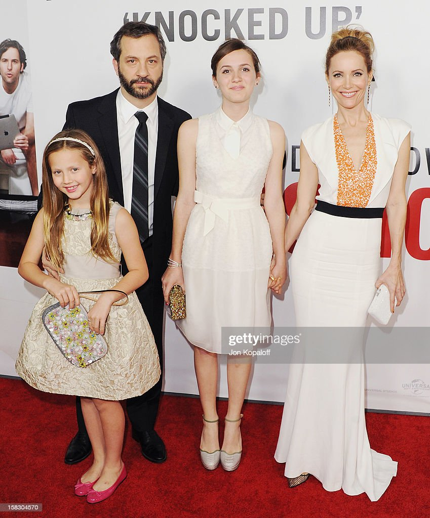 Director Judd Apatow (L), wife actress Leslie Mann (R) and daughters Maude Apatow (M) and Iris Apatow (far right) arrive at the Los Angeles Premiere 'This Is 40' at Grauman's Chinese Theatre on December 12, 2012 in Hollywood, California.