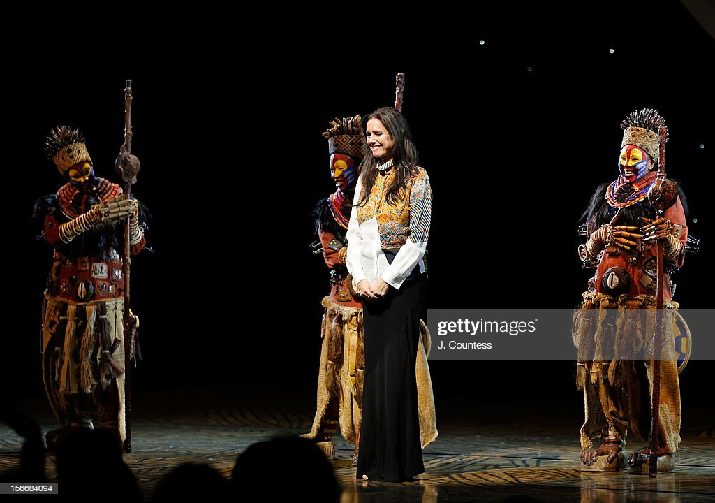 Director Julie Taymor joins the cast to take a bow during 'The Lion King' Broadway 15th Anniversary Celebration at Minskoff Theatre on November 18, 2012 in New York City.