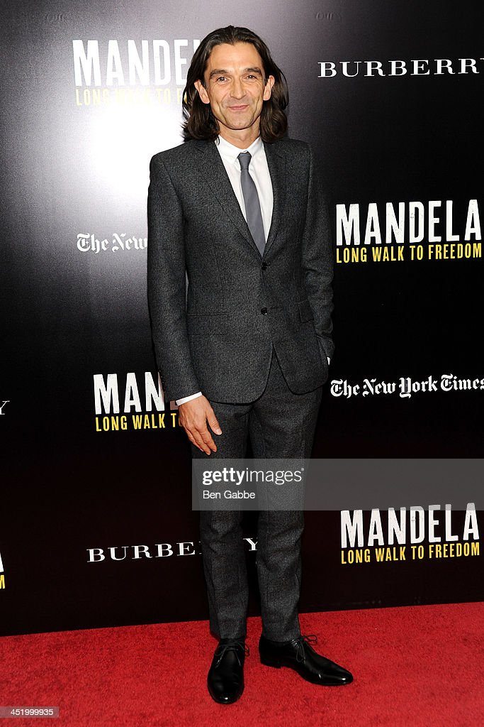 Director <a gi-track='captionPersonalityLinkClicked' href=/galleries/search?phrase=Justin+Chadwick&family=editorial&specificpeople=4584510 ng-click='$event.stopPropagation()'>Justin Chadwick</a> attends the screening of 'Mandela: Long Walk to Freedom', hosted by U2, Anna Wintour and Bob & Harvey Weinstein, with Burberry at the Ziegfeld Theater on November 25, 2013 in New York City.