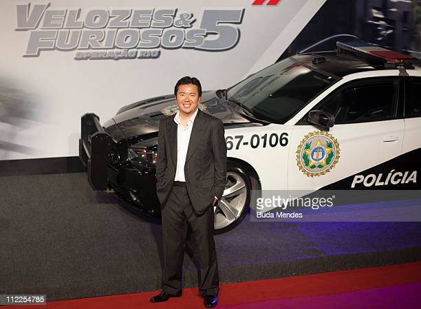 Director Justin Lee poses for photographers during the premiere of the movie 'Fast and Furious 5' at Cinepolis Lagoon on April 15 2011 in Rio de...