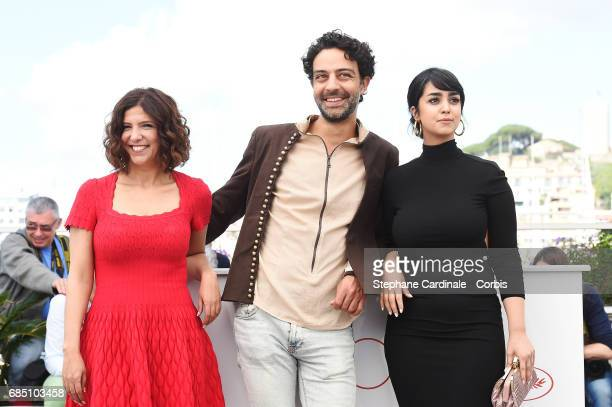 Director Kaouther Ben Hania Actors Ghanem Zrelli and Mariam Al Ferjani attend 'Alaka Kaf Ifrit ' Photocall during the 70th annual Cannes Film...