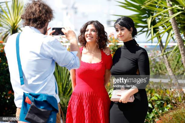 Director Kaouther Ben Haniaand actress Mariam Al Ferjani pose for a picture during the 'Alaka Kaf Ifrit ' photocall during the 70th annual Cannes...