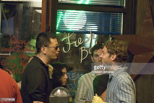 Director Kar Wai Wong and Jude Law talk at the set of 'My Blueberry Nights' on Grand Street in SoHo on June 22 2006 in New York City