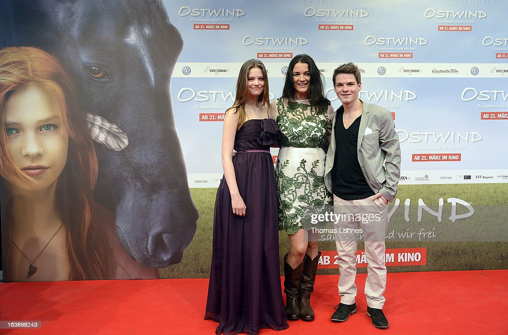Director Katja von Garnier (C) poses with Actress Hanna Binke (L) and Actor Marvin Linke on the red carpet for the premiere of the film 'Ostwind' on March 17, 2013 in Frankfurt am Main, Germany. The family film portrays the friendship between the young Mika (Hanna Binke) and the wild and shy stallion 'Ostwind' (east wind). Marvin Linke is seen in the film as Sam.