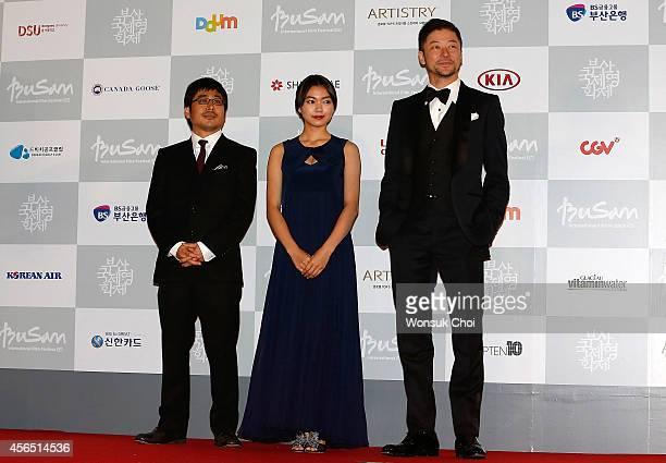 Director Kazuyoshi Kumakiri actress Fumi Nikaido and actor Tadanobu Asano pose for the photographers during the opening ceremony of the 19th Busan...