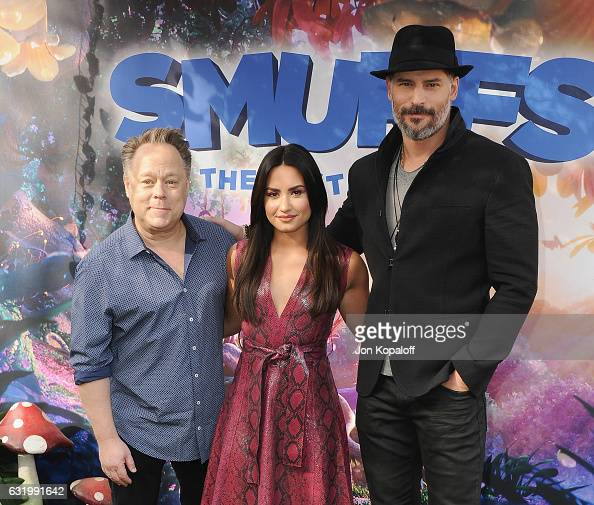 Director Kelly Asbury Demi Lovato and Joe Manganiello pose at the Photo Call For Sony Pictures Releasing's 'Smurfs The Lost Village' at Sony Pictures...