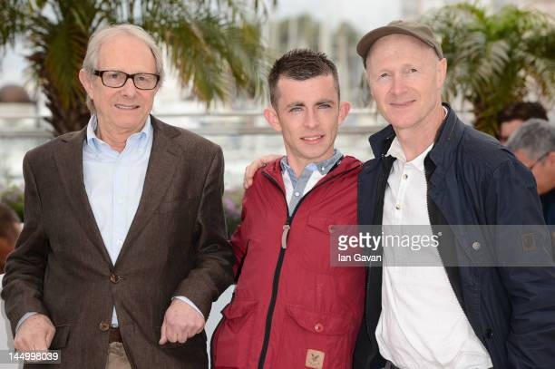 Director Ken Loach actor Paul Brannigan and screenwriter Paul Laverty pose at the 'The Angels' Share' photocall during the 65th Annual Cannes Film...