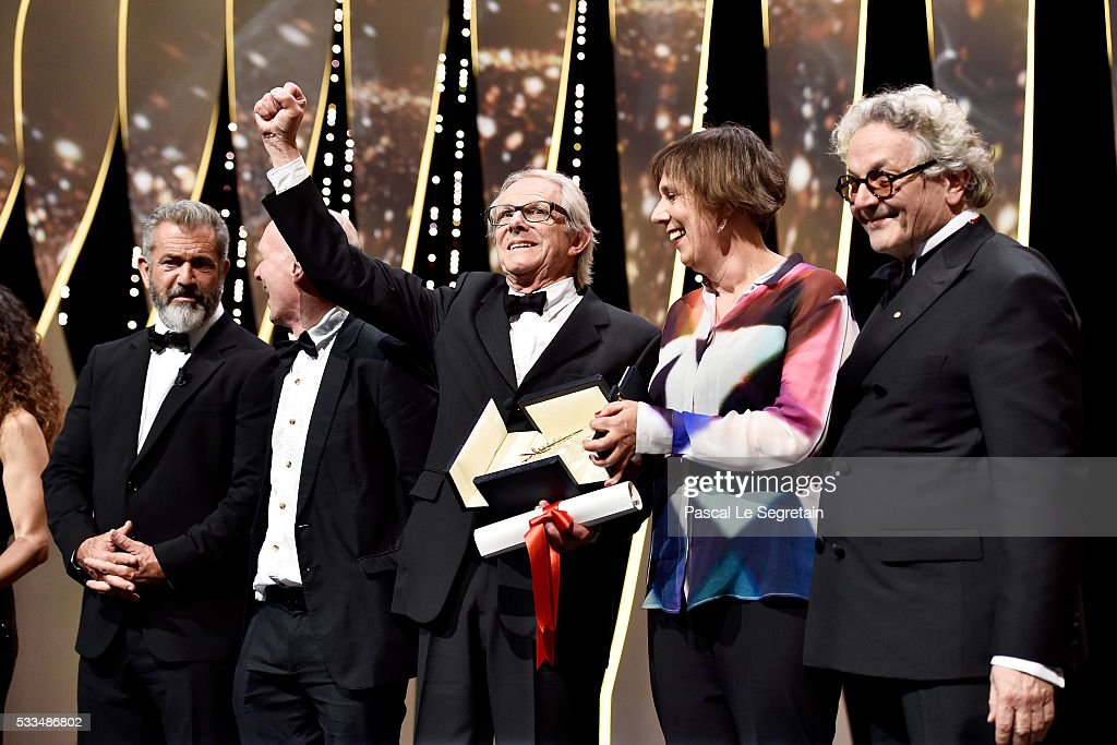 Director Ken Loach celebrates with Mel Gibson screenwriter Paul Laverty producer Rebecca O'Brien and director and President of the Jury George Miller...