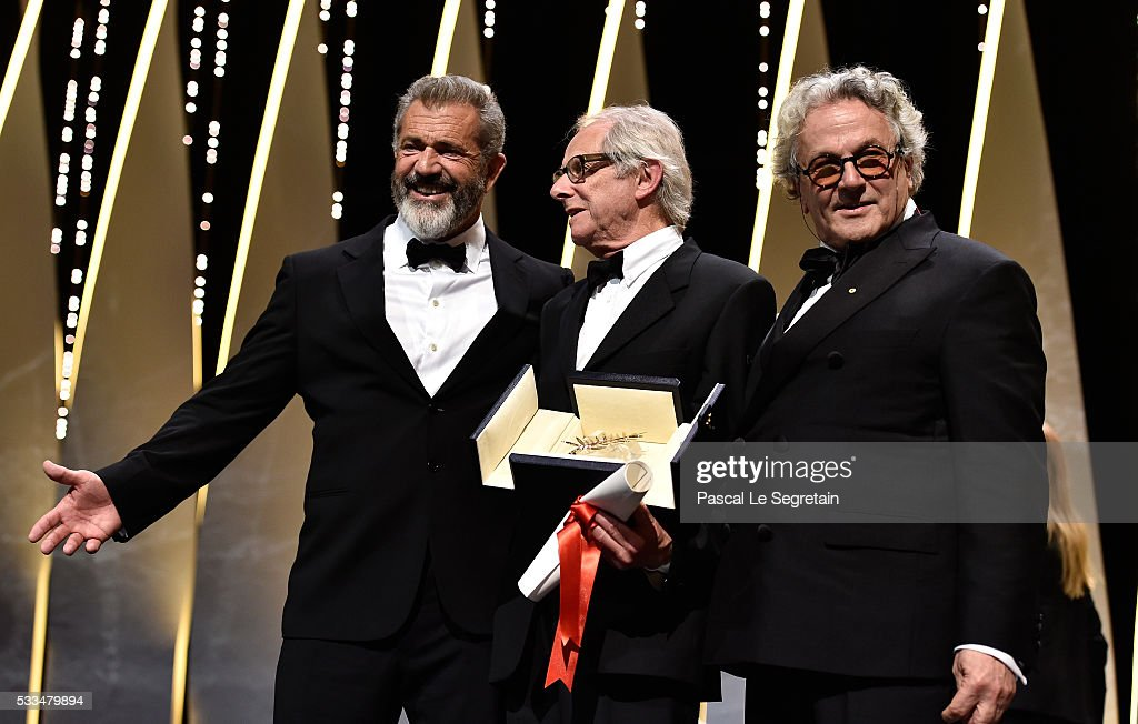 Director Ken Loach speaks with Mel Gibson and director and President of the Jury George Miller after being awarded the Palme d'Or for the movie 'I...