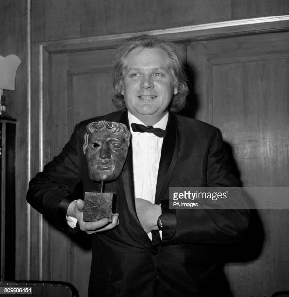 Director Ken Russell who holds aloft the Desmond Davis Award presented to him at the Guild of Television Producers and Directors Awards Ball at the...