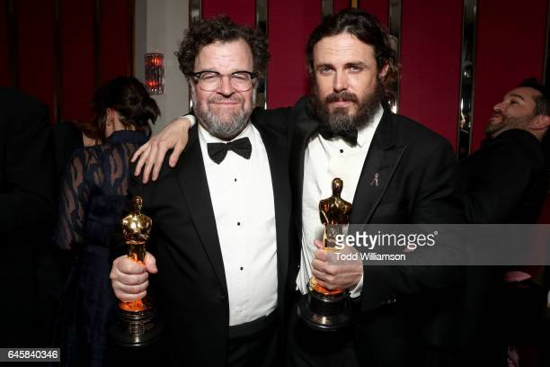 Director Kenneth Lonergan and actor Casey Affleck with their awards for 'Manchester By The Sea' attend the Amazon Studios Oscar Celebration at...