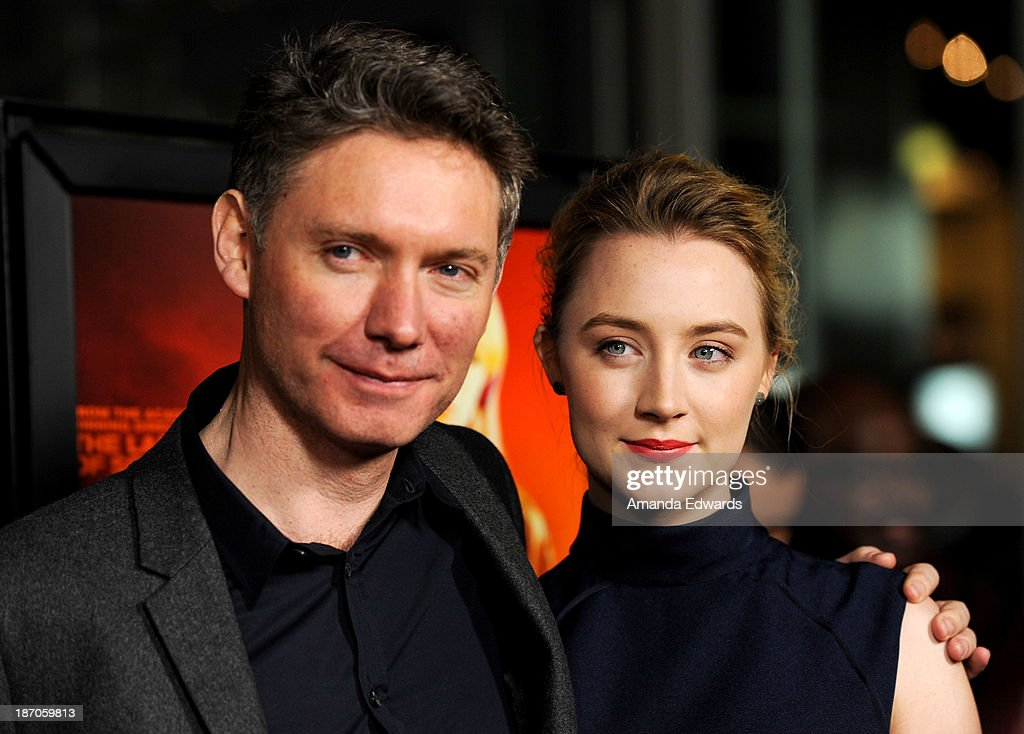 Director Kevin Macdonald and actress Saoirse Ronan arrive at the Los Angeles premiere of 'How I Live Now' at ArcLight Hollywood on November 5 2013 in...