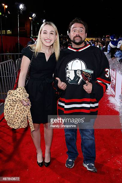 Director Kevin Smith and daughter Harley Quinn Smith arrive to the premiere of 'The Night Before' at The Theatre At The Ace Hotel on November 18 2015...