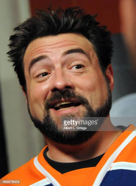 Director Kevin Smith arrives for the Premiere Of A24's 'Tusk' held at the Vista Theatre on September 16 2014 in Los Angeles California