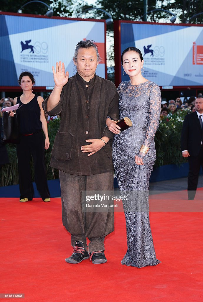 Director <a gi-track='captionPersonalityLinkClicked' href=/galleries/search?phrase=Kim+Ki-Duk&family=editorial&specificpeople=2212557 ng-click='$event.stopPropagation()'>Kim Ki-Duk</a> (L) and Cho Min-soo attend Award Ceremony during The 69th Venice Film Festival at the Palazzo del Cinema on September 8, 2012 in Venice, Italy.