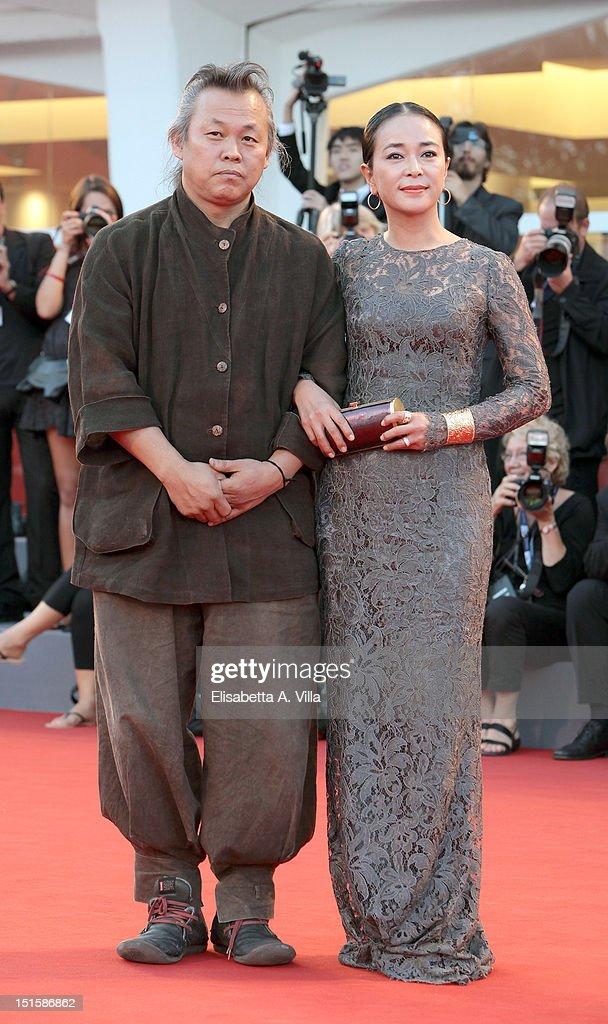 Director Kim Ki-Duk Duk (L) and Cho Min-soo attend the Award Ceremony during The 69th Venice Film Festival at the Palazzo del Cinema on September 8, 2012 in Venice, Italy.