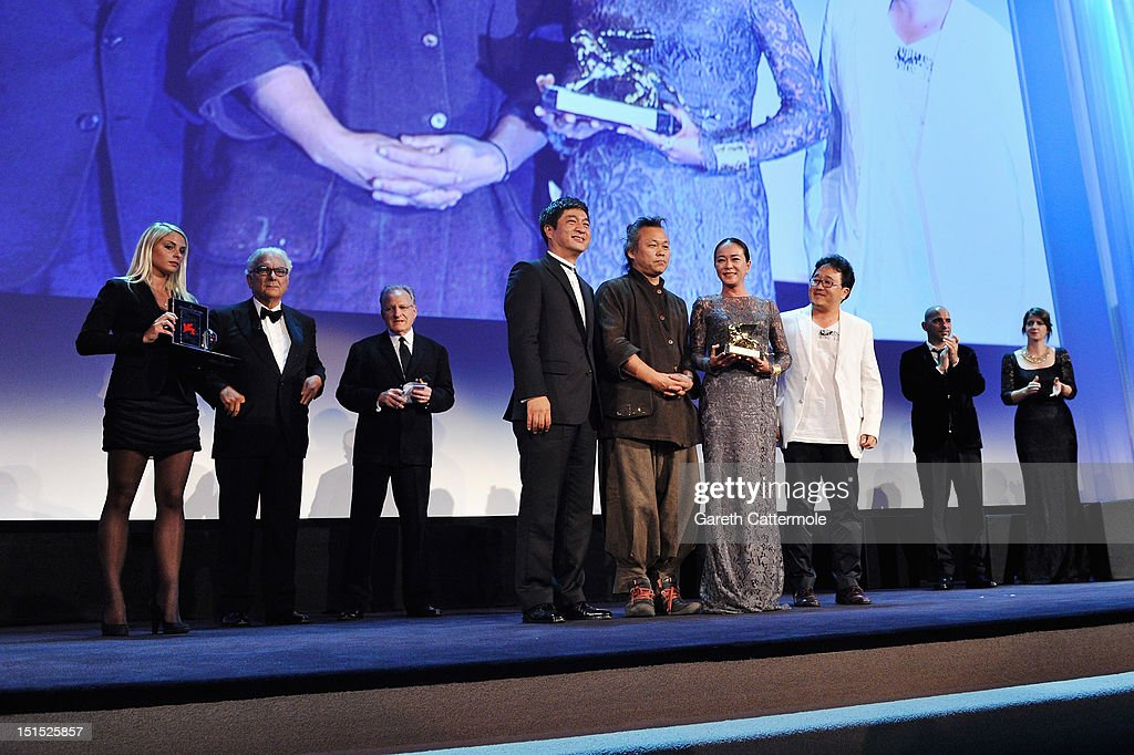Director <a gi-track='captionPersonalityLinkClicked' href=/galleries/search?phrase=Kim+Ki-Duk&family=editorial&specificpeople=2212557 ng-click='$event.stopPropagation()'>Kim Ki-Duk</a> (centre, 2nd L) wins the Golden Lion for best film award as actress <a gi-track='captionPersonalityLinkClicked' href=/galleries/search?phrase=Cho+Min-soo&family=editorial&specificpeople=9692438 ng-click='$event.stopPropagation()'>Cho Min-soo</a> (centre, 2nd R) looks on during the Award Ceremony at the 69th Venice Film Festival at the Palazzo del Cinema on September 8, 2012 in Venice, Italy.