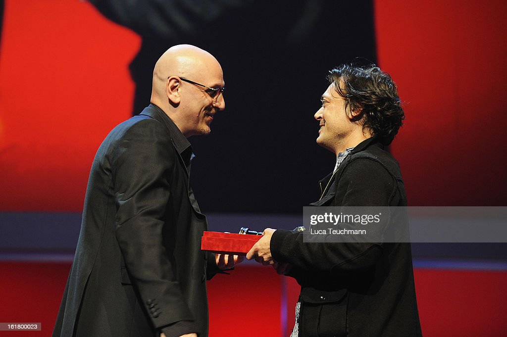 Director Kim Mordaunt (R) receives the award for best debut at the Closing Ceremony during the 63rd Berlinale International Film Festival at Berlinale Palast on February 14, 2013 in Berlin, Germany.