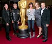 Director Kirk DeMicco animator Chris Sanders and producers Kristine Belson Jane Hartwell and Jeffrey Katzenberg attend the 86th Annual Academy Awards...