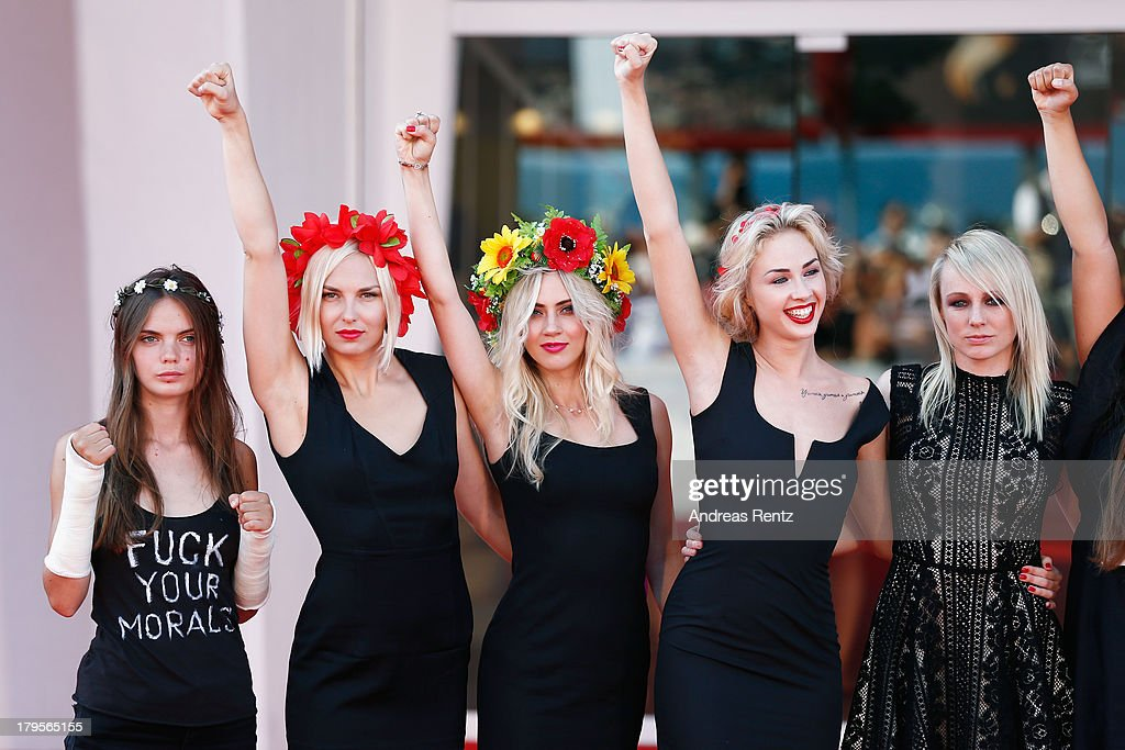 Director Kitty Green (R), Femen activist Sasha Shevchenko (2ndR) and fellow activists attend the 'Sacro Gra' Premiere during the 70th Venice International Film Festival at the Palazzo del Cinema on September 5, 2013 in Venice, Italy.