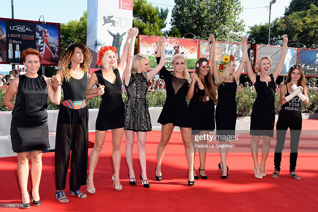 Director Kitty Green (4thL), Femen activists Inna Shevchenko (5thL), Sasha Shevchenko (2ndR) and fellow activists attend the 'Sacro Gra' Premiere during the 70th Venice International Film Festival at the Palazzo del Cinema on September 5, 2013 in Venice, Italy.