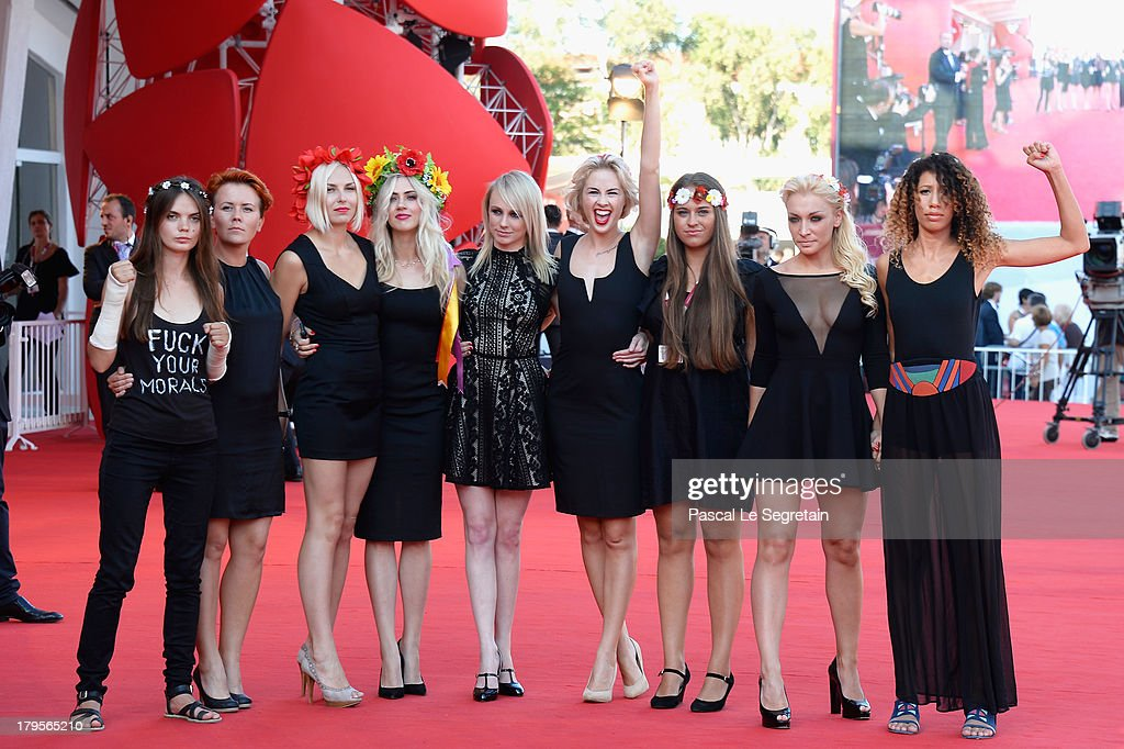Director Kitty Green (5thL), Femen activists Sasha Shevchenko (4thR), Inna Shevchenko (2ndR) and fellow activists attend the 'Sacro Gra' Premiere during the 70th Venice International Film Festival at the Palazzo del Cinema on September 5, 2013 in Venice, Italy.